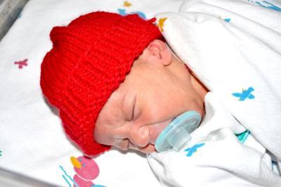 a91b04ce32a Babies wear red hats to raise heart disease awareness