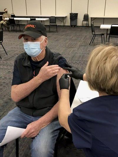 Heath officials work on scheduling second COVID-19 vaccines