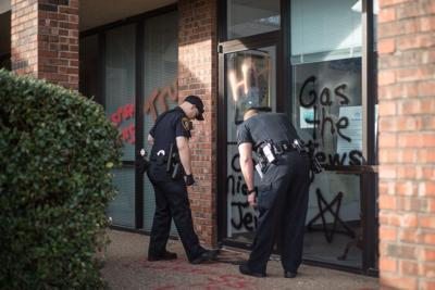 Norman police arrest woman in connection with racist graffiti | News