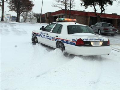 A Lawton Okla Police Cruiser Tries To Navigate The Snow As Blizzard Conditions Hit Southwest Oklahoma At Midday Tuesday Dec