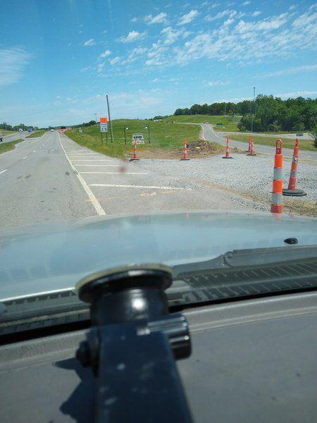 Bridge closed; exit for church, disc golf