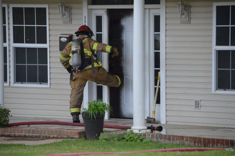 Woman charged with arson in June fire