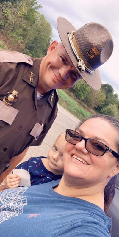 Trooper helps with flat tire
