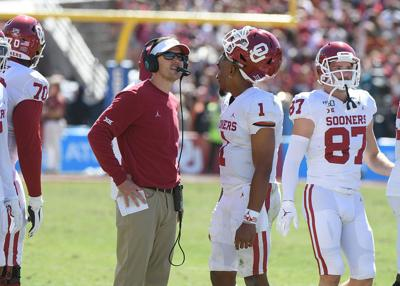 Oklahoma Head coach Lincoln Riley and Oklahoma Sooners quarterback Jalen Hurts (1) in the game between OU and Texas at the Cotton Bowl on October 12, 2019 in Dallas, Texas. (june frantz hunt/ norman transcript)