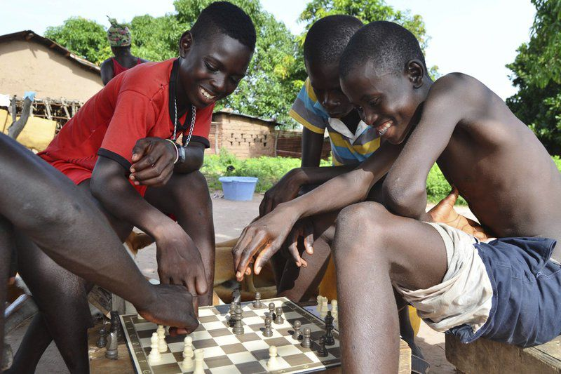 Chess provides bond between Oklahoman, African youth
