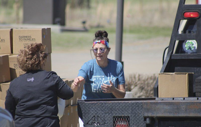 'There's a need': Volunteers happy to help neighbors with Farmers to Families food giveaways
