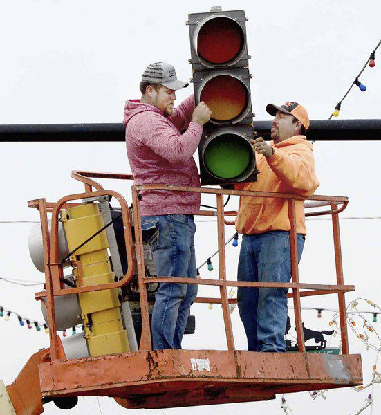 Workers remove traffic lights at downtown intersection