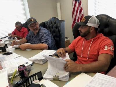 Commissioners plan to install protective glass in offices