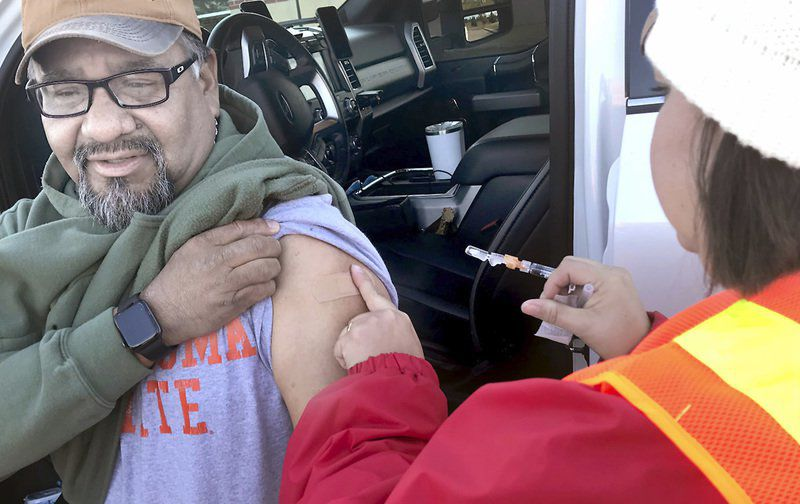 Residents roll up for drive-through flu clinic