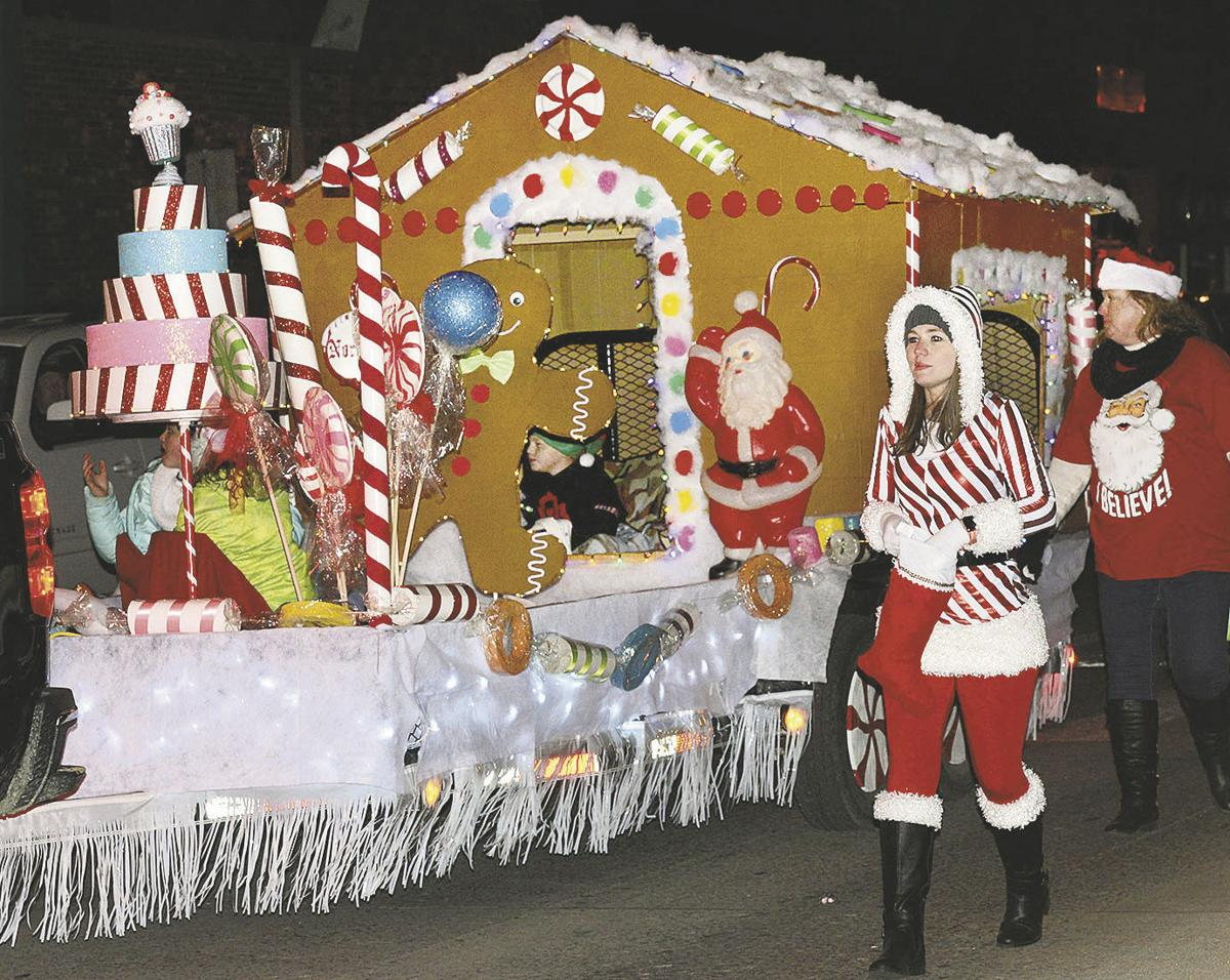 the designer cake float rolls by during the christmas parade thursday in mcalester