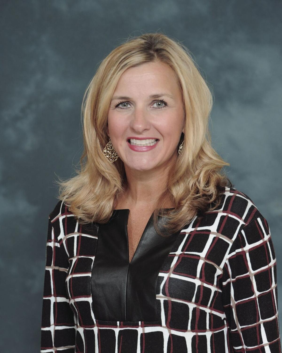 School board extends Rhodes' contract