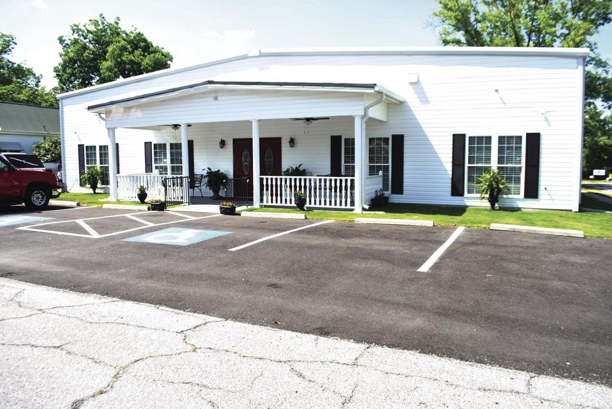 Taylor Funeral Home reopens with dedication