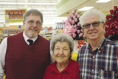 Carl Axon takes a breath after years of service in grocery