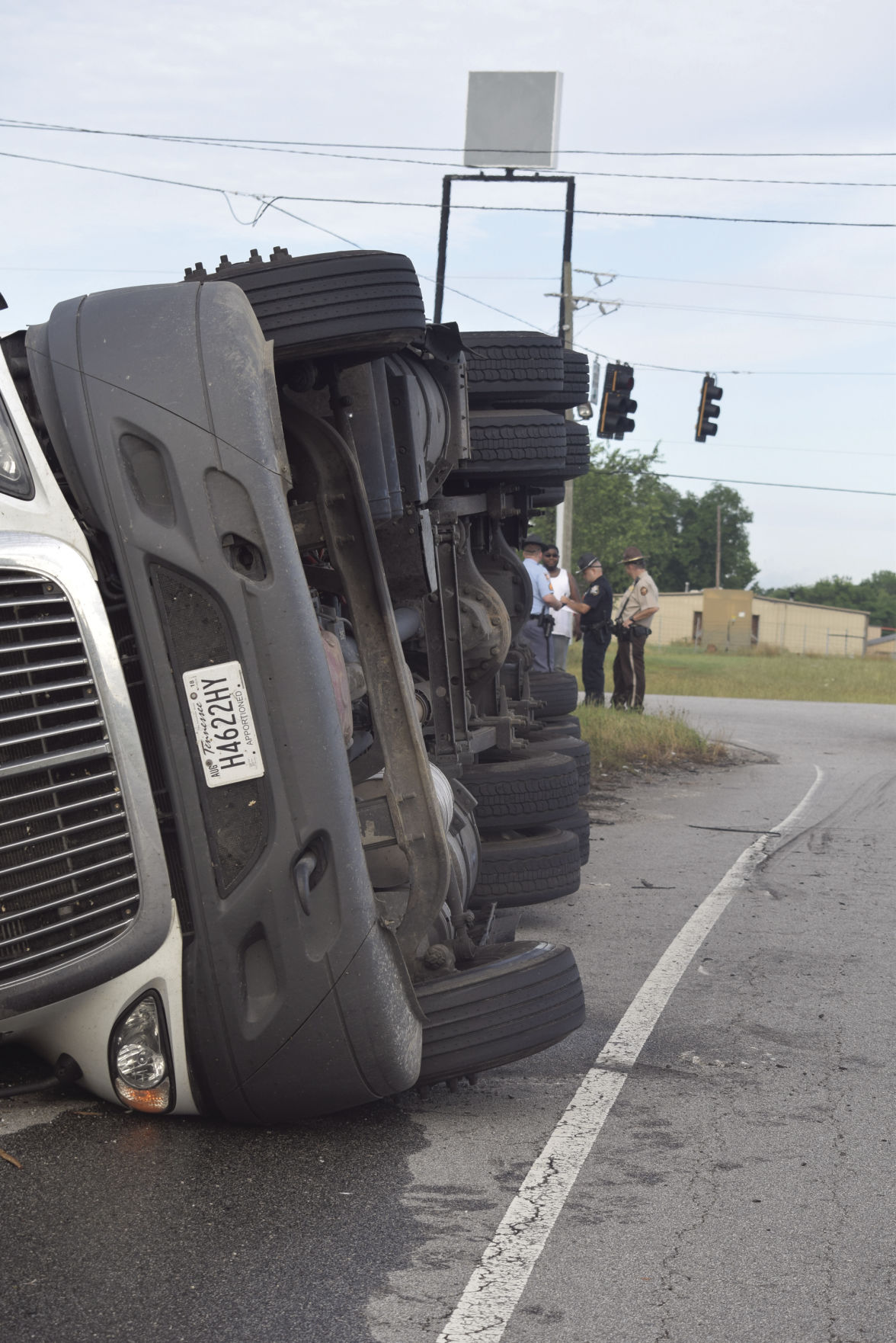Tractor-trailer overturns at I-20 ramp after load shifts