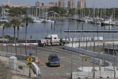AUTO RACING: IndyCar postpones Indy 500, goes virtual