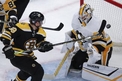 NHL: Marchand carries Bruins to win over Penguins