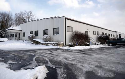 Kuhn buys larger facility