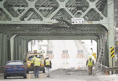 FULL STORY: Truck crash damages, closes bridge between