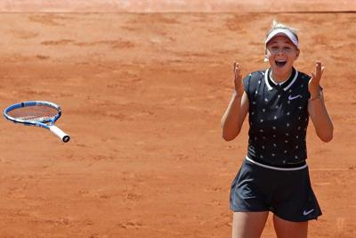 TENNIS: Anisimova tops defending champ Halep in quarters