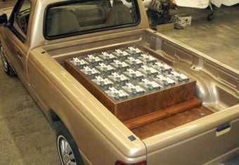 Batteries Shown In Bed Of Light Green Truck