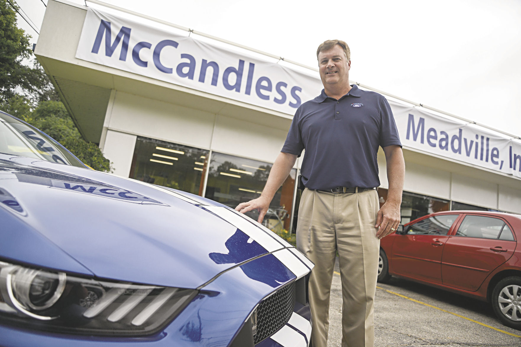 Greg McCandless, The New Owner Of The Former Weber Harris Ford, Stands Near  A Mustang In The Front Lot Of McCandless Ford.