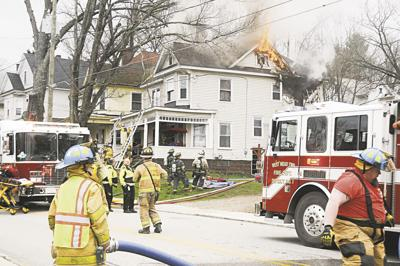 Firefighters at 717 Baldwin St.