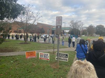 Early voting begins locally; residents wait hours to cast ballots