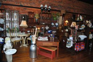 """<p class=""""p1"""">Brick Alley Antiques store owner Gill Lunsford says she is happy to return to the downtown business district.</p>"""