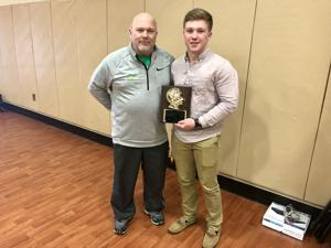 <p>Senior linebacker Cole Forshee was recognized as this year's recipient of the Golden Helmet award. Forshee is pictured here with head football coach John Kirby.</p>