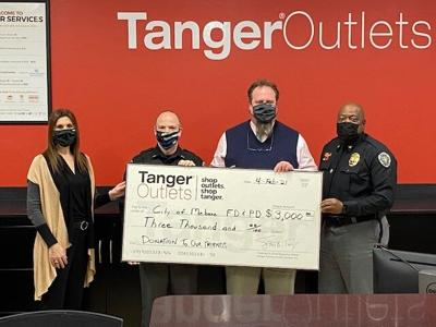 Tanger Outlets makes donations to local police and fire departments