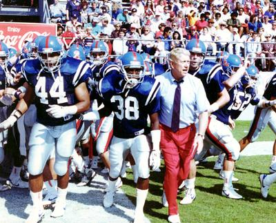 former ole miss football coach billy brewer is pictured prior to a game during his coaching career