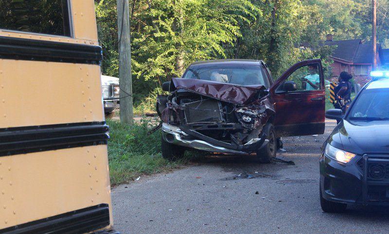 Meridian school bus struck by pickup truck