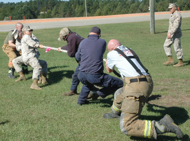 marines from mats 1 of nas meridian squared off against firefighters with the meridian fire department friday during the marine firefighter challenge held