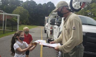 Northeast Elementary School gives thank you cards, lip balm to utility workers