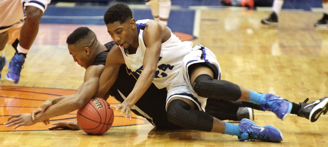 Edwards battles for loose ball