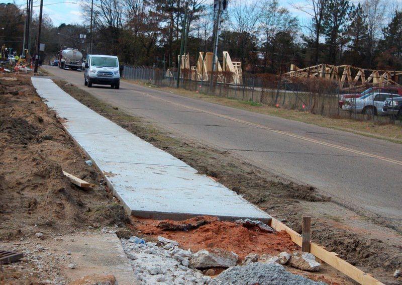 Sidewalk work underway on Old Highway 80 West in Meridian