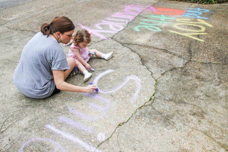 Meridian children create inspiring messages with sidewalk chalk