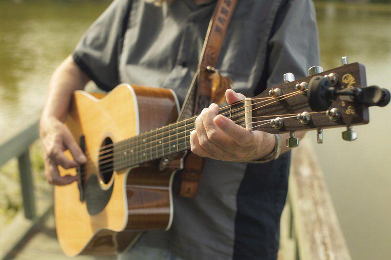 Retired art teacher keeps busy writing, performing songs