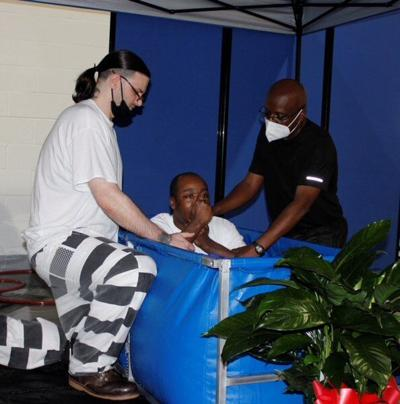 Meridian native assists with baptisms at Wilkinson County prison