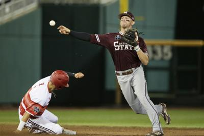 best loved 774f1 aaf19 CWS Mississippi St Louisville Baseball. Mississippi State shortstop Jordan  Westburg throws to first base after forcing out Louisville s Drew Campbell  ...