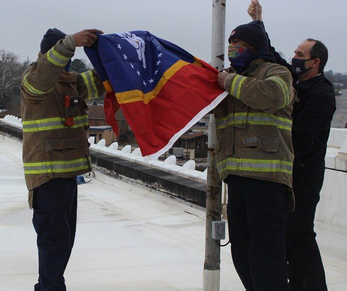 """A special moment"": Firefighters raise new state flag at Meridian City Hall"