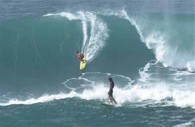 5d1dc4cf29 Big-wave surfers gather in Hawaii for prestigious event