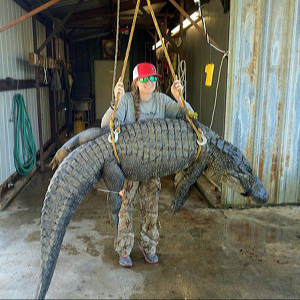 MIKE GILES: Young woman lands a couple of monster gators