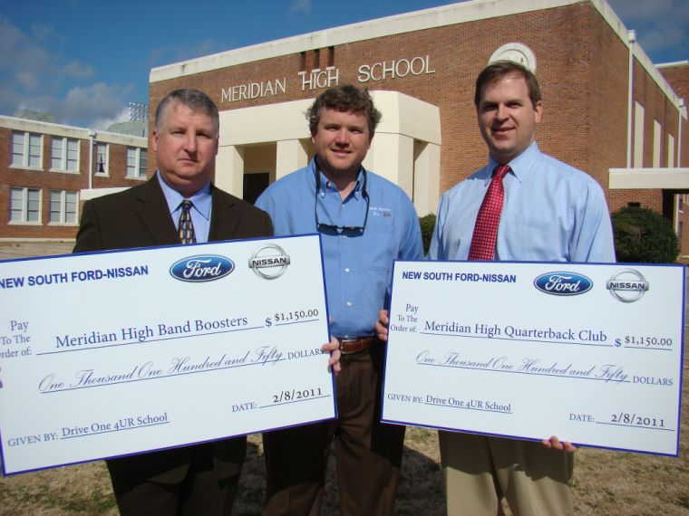 Michael Van Veckhoven, General Manager Of New South Ford, Center, Presents  Giant Cardboard Checks To Brian Kelly Of The Meridian High School Band  Boosters, ...