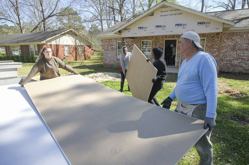 Boston college students flock to Meridian to help build Habitat For Humanity house