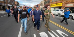 Marching to honor area Special Olympics athletes