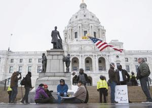 With heavy security in place, pro-Trump rally draws small group at Minnesota Capitol