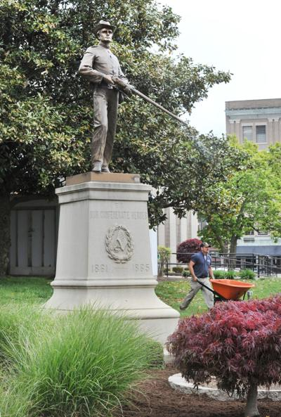 Both sides claim statue ownership in dispute