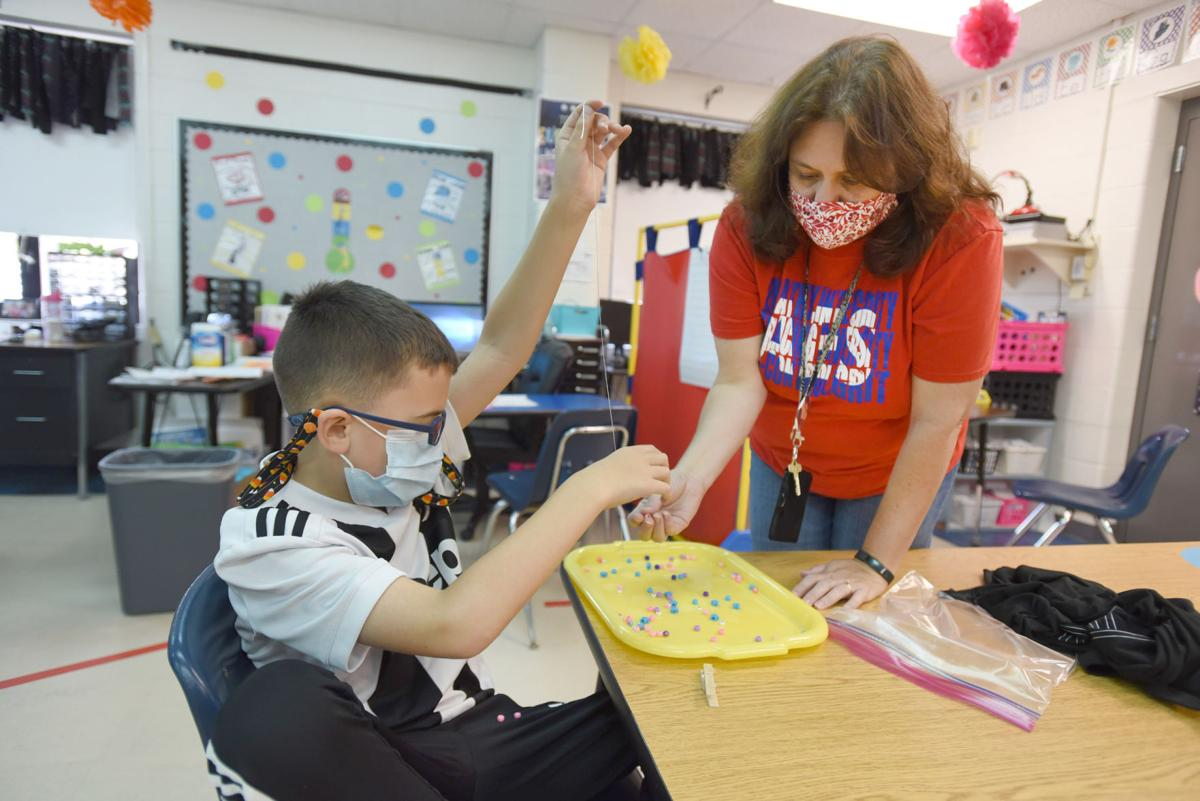 Audubon students make mask holders as part of lesson work