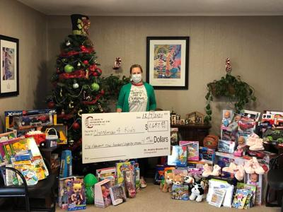 Calhoun Chiropractic Center donates toys, money to local program